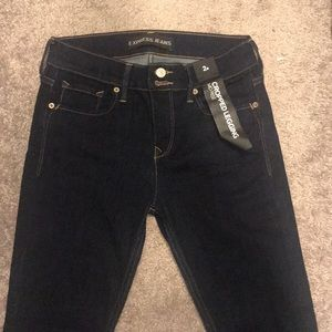 Express dark colored mid rise crop jeans with tags